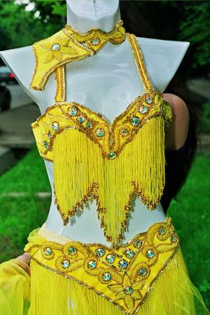 ...костюмы из Турции, украшенные стразами Swarowski.